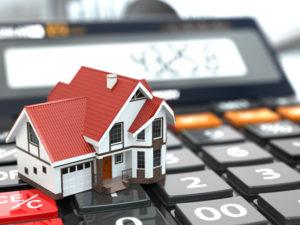 real estate on calculator deposit mortgage wealth noir